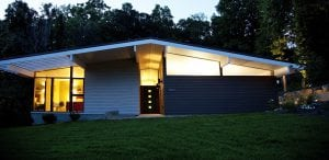 home with premium Hardie siding at night