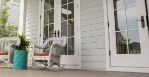 Hadie lap siding with deck and rocking chairs